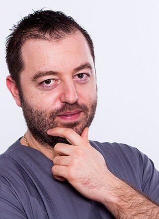 Dr. Alecsandru IONESCU - IMPLANTOLOGIE / ESTETICA DENTO-FACIALA